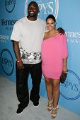 HOLLYWOOD, CA - JULY 13: Marcellus Wiley (L) and Jazmin Lopez (R) attend Fat Tuesday at The ESPYs on