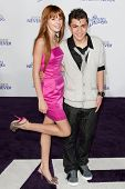 LOS ANGELES, CA - FEB 8: Actor Adam Irigoyen & Actress Bella Thorne arrive at the Justin Bieber: Never Say Never premiere at Nokia Theater L.A. Live on February 8, 2011 in Los Angeles, California.