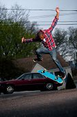 Skateboarder Man Doing A Kick Flip