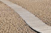 An alley on a pebbles beach