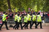 LONDON, UK - APRIL 29: Policemen walking on the Mall at Prince William and Kate Middleton wedding, April 29, 2011 in London, United Kingdom