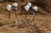 Shovels and hardhats at a groundbreaking