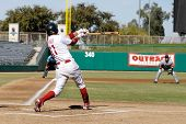 MESA, AZ - NOV 20: Quintin Berry of the Mesa Solar Sox swings in the Arizona Fall League baseball game between the Solar Sox and the Scottsdale Scorpions on November 20, 2008 in Mesa, Arizona.