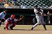 MESA, AZ - NOV 20: Chris Johnson of  the Scottsdale Scorpions swings with Mesa Solar Sox catcher Lou Marson behind the plate, in the Arizona Fall League game on November 20, 2008 in Mesa, Arizona.