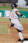MESA, AZ - NOV 20: Brian Bogusevic of the Scottsdale Scorpions rounds first base in the Arizona Fall