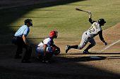 MESA, AZ - NOV 20: Jamie Romak of the Scottsdale Scorpions hits with catcher Lou Marson of the Mesa Solar Sox behind the plate in the Arizona Fall League game on November 20, 2008 in Mesa, Arizona.