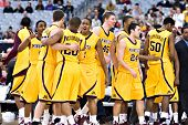 GLENDALE, AZ - DECEMBER 20: University of Minnesota Gophers basketball team celebrates after defeati