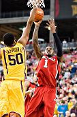 GLENDALE, AZ - DECEMBER 20: Louisville's Terrence Williams #1 shoots the ball over defender Ralph Sa