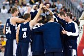 GLENDALE, AZ - DECEMBER 20: The Brigham Young University basketball team huddles before their game w