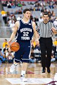 GLENDALE, AZ - DECEMBER 20: Brigham Young University guard Jimmer Fredette #32 dribbles upcourt in t