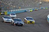 AVONDALE, AZ - APRIL 18: Casey Mears #07 leads a group of cars in the NASCAR Sprint Cup race at the Phoenix International Raceway on April 18, 2009 in Avondale, AZ.