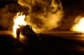 CHANDLER, AZ - APRIL 25: A jet powered drag car ignites its engine at the Firebird International Raceway on April 25, 2009 in Chandler, AZ.