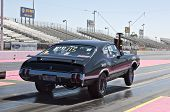 CHANDLER, AZ - OCTOBER 1: A hot rod car pops a wheelie at the start of the race at the NHRA Pacific