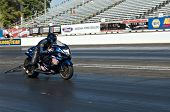 CHANDLER, AZ - OCTOBER 1: A motorcycle competes in the NHRA Pacific Division drag racing championshi