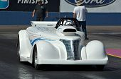 CHANDLER, AZ - OCTOBER 1: A hot rod car competes in the NHRA Pacific Division drag racing championsh