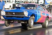 CHANDLER, AZ - OCTOBER 2: A hot rod car pops a wheelie at the start of the race at the NHRA Pacific