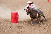 APACHE JUNCTION, AZ - FEBRUARY 26: A female competitor rides a horse in the barrel race competition