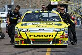AVONDALE, AZ - APRIL 10: The pit crew pushes the #99 Subway Ford car, driven by Carl Edwards, onto t