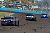 AVONDALE, AZ - APRIL 10: Scott Speed (#47) follows a group of cars into turn two at the Subway Fresh Fit 600 NASCAR Sprint Cup race on April 10, 2010 in Avondale, AZ.