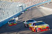 AVONDALE, AZ - APRIL 10: Kevin Harvick (#29) leads a group of cars into turn one at the Subway Fresh