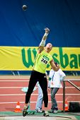 VIENNA, AUSTRIA - FEBRUARY 21: Indoor track and field championship: Roland Schwarzl places fifth in men's shot put event February 21, 2009 in Vienna, Austria.