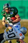 KORNEUBURG, AUSTRIA - April 4: Austrian Football League:  RB Andrej Kliman (#3, Dragons) and his team lose 35:52 to Tirol Raiders on April 4, 2009 in Korneuburg, Austria.