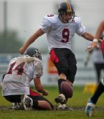 KORNEUBURG,  AUSTRIA - JUNE 20: Austrian Football League: Kicker Philipp Schubert (#9, Lions) and hi