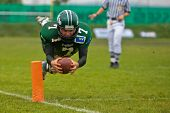 KORNEUBURG,  AUSTRIA - JUNE 20: Austrian Football League: QB Ryan Rufener (#7, Dragons) and his team