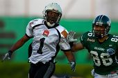 KORNEUBURG, AUSTRIA - APRIL 17: WR Jason Horton (Dragons #86) and QB Fred Wells (#1, Panthers) at Da