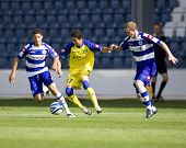 LONDON, UK AUGUST 2, Diego Farias evades Damien Delaney at the pre-season friendly football match be