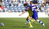 LONDON, UK AUGUST 2, Marco Malago holds off a defender at the pre-season friendly football match bet