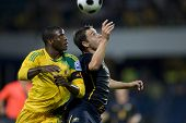 LONDON, UK AUGUST 19 Aaron Mokoena and Luke Wilkshire compete for the ball playing in the internatio
