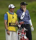 GLENEAGLES SCOTLAND AUGUST 29, England's David Howell mulls over a shot with his Caddie whilst compe