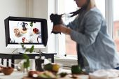 Computer monitor on workplace of food designer and photographer shooting food poster