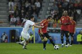 INNSBRUCK - JUNE 10: Yuri Zhirkov of Russia (in white) & Santi Cazorla of Spain (in red)  during the
