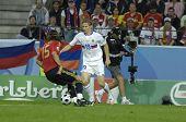 INNSBRUCK - JUNE 10: Sergio Ramos of Spain (in red) & Roman Pavlyuchenko of Russia (in white) during the match Spain-Russia 4:1 Euro2008 Group D. June 10, 2008, in Innsbruck, Austria