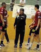 NAGYATAD, HUNGARY - FEBRUARY 5: Lajos Mocsai Veszprem coach (C) gives instruction at Hungarian Cup H