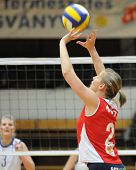 KAPOSVAR, HUNGARY - FEBRUARY 4: Dora Kotel posts the ball in the Hungarian Cup woman volleyball game Kaposvar vs Vasas, February 4, 2009 in Kaposvar, Hungary.