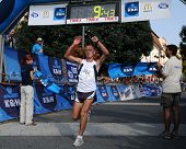 KAPOSVAR, HUNGARY - SEPTEMBER 20: Tamas Nagy celebrates at the finish line during the K&H Running Day running race September 20, 2009 in Kaposvar, Hungary.