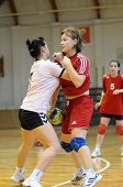 KAPOSVAR, HUNGARY - NOVEMBER 29: Bernadett Sardi (in red) in action at Hungarian Handball National C
