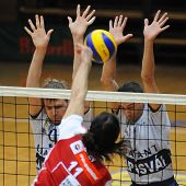 KAPOSVAR, HUNGARY - DECEMBER 8: Kovacs (L), Nagy (C) and Kantor (R) in action at a CEV Cup volleyball game Kaposvar (HUN) vs Hotvolleys Wien (AUT), December 8, 2009 in Kaposvar, Hungary
