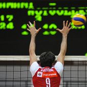 KAPOSVAR, HUNGARY - JANUARY 22: Guilherme blocks the ball at a Middle European League volleyball gam