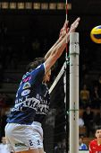 KAPOSVAR, HUNGARY - JANUARY 31: Robert Koch (2) blocks  the ball at a Middle European League volleyb