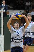 KAPOSVAR, HUNGARY - MARCH 7: Robert Koch (L) posts the ball at a Middle European League volleyball g