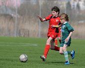 KAPOSVAR, HUNGARY - MARCH 21: Marton (L) and Kiraly (R) in action at the Hungarian National Championship under 13 game between Kaposvari Rakoczi FC and Pecsi MFC March 21, 2010 in Kaposvar, Hungary.
