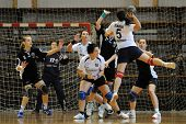 KAPOSVAR, HUNGARY - APRIL 18: Szabina Reichert (with the ball) in action at Hungarian Handball Natio
