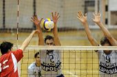 KECSKEMET, HUNGARY - APRIL 27: Koch (C) and Kovacs (R) blocks the ball at a Hungarian National Champ