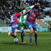 KAPOSVAR, HUNGARY - APRIL 10: Bakos (L), Gujic (C) and Dobric (R) in action at a Hungarian National