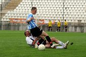 KAPOSVAR, HUNGARY - JUNE 19: Attila Nagy (in blue) in action at a Somogy County Championship II. fin