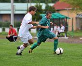 KAPOSVAR, HUNGARY - SEPTEMBER 4: Daniel Pager (R) in action at the Hungarian National Championship under 19 game between Kaposvari Rakoczi and Nyirsuli September 4, 2010 in Kaposvar, Hungary.